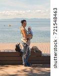 young mother walking with a... | Shutterstock . vector #721548463