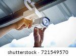 technician installing cctv... | Shutterstock . vector #721549570