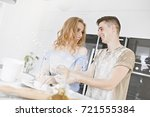 couple is playing with flour ...   Shutterstock . vector #721555384