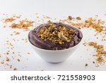 acai with banana and granola on ... | Shutterstock . vector #721558903