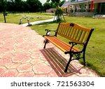 wooden brown bench at park | Shutterstock . vector #721563304
