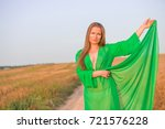 attractive woman in the field | Shutterstock . vector #721576228
