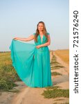 attractive woman in the field | Shutterstock . vector #721576240