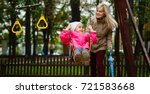 mother and daughter in a swing... | Shutterstock . vector #721583668