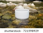 crystal singing bowl into the... | Shutterstock . vector #721598929