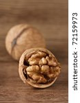 The chopped walnut on a brown wooden table. - stock photo