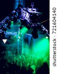 Small photo of Odessa, Ukraine July 14, 2014: Ibiza night club. Night club dj party people enjoy of music dancing sound with colorful light with Smoke Machine and lights show. Hands up in the earth.
