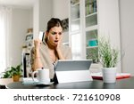 worried woman suffering online... | Shutterstock . vector #721610908