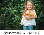 Happy Little Girl Holding...