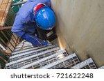 male  worker wearing protective ... | Shutterstock . vector #721622248