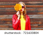pretty woman with autumn yellow ... | Shutterstock . vector #721633804