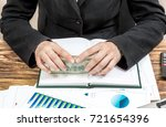 businesswoman holding money on... | Shutterstock . vector #721654396