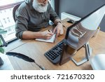 concentrated elderly man is... | Shutterstock . vector #721670320