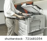 man copying paper from... | Shutterstock . vector #721681054