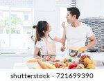 asian lovers feeding fruit and... | Shutterstock . vector #721699390