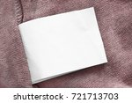 white blank clothes label on... | Shutterstock . vector #721713703