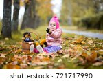 a little girl playing  with... | Shutterstock . vector #721717990