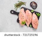 raw chicken breast with fresh... | Shutterstock . vector #721725196