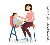 mother feeding baby with spoon... | Shutterstock .eps vector #721733293