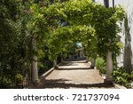 walkway through the arches... | Shutterstock . vector #721737094
