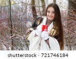 young beautiful girl in winter... | Shutterstock . vector #721746184