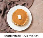 top view of homemade pancakes.... | Shutterstock . vector #721746724