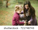 a young and pretty mother in an ... | Shutterstock . vector #721748743