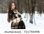 young beautiful girl in winter... | Shutterstock . vector #721750498