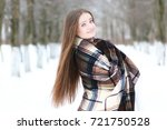 young beautiful girl in winter... | Shutterstock . vector #721750528