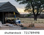 Lioness Drinking In A Camp Sit...