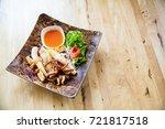 fried squids in wood plate...   Shutterstock . vector #721817518
