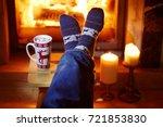 man's feet in warm socks with... | Shutterstock . vector #721853830