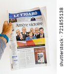 Small photo of PARIS, FRANCE - SEP 25, 2017: International newspaper with portrait of Angela Merkel after election in Germany for the Chancellor of Germany, the head of the federal government
