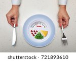 hands with kitchen flatware and