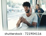 bearded hipster guy is reading... | Shutterstock . vector #721904116