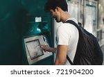 student guy is buying tickets... | Shutterstock . vector #721904200
