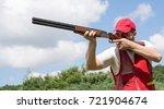 man shooting skeet with a...   Shutterstock . vector #721904674