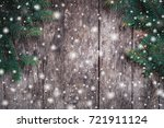 christmas fir branches on... | Shutterstock . vector #721911124