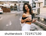 beautiful girl with phone in... | Shutterstock . vector #721917130