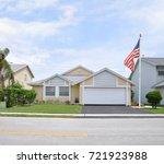 american flag suburban home... | Shutterstock . vector #721923988