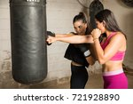 woman and her boxing instructor ... | Shutterstock . vector #721928890