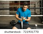 handsome young man doing a hand ...   Shutterstock . vector #721931770