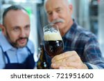 Small photo of workers adoring the frothy beer