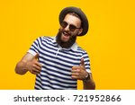 smiling hipster man in hat and... | Shutterstock . vector #721952866