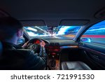 driver in a car moves at fast... | Shutterstock . vector #721991530
