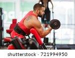 handsome sporty man flexing... | Shutterstock . vector #721994950