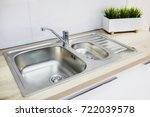 a metal faucet with a sink in... | Shutterstock . vector #722039578