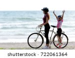 mom and baby on bicycle  at... | Shutterstock . vector #722061364