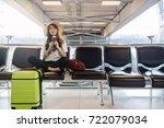 happy asian woman traveler... | Shutterstock . vector #722079034