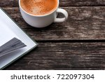 white cup of coffee and a book... | Shutterstock . vector #722097304